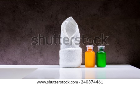 Soap and shampoo with towels in the bathroom - stock photo