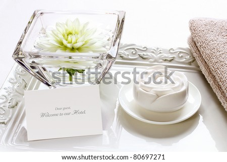 Soap and towel for refreshment to welcome new hotel guests - stock photo