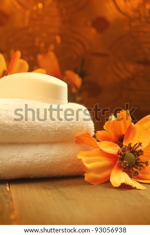 soap bar on a white towels with orange flowers
