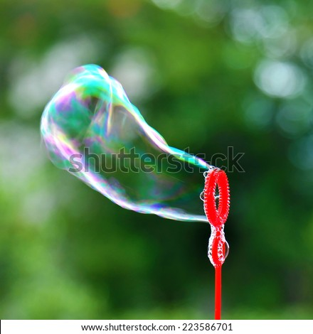 Soap bubble blowing - stock photo