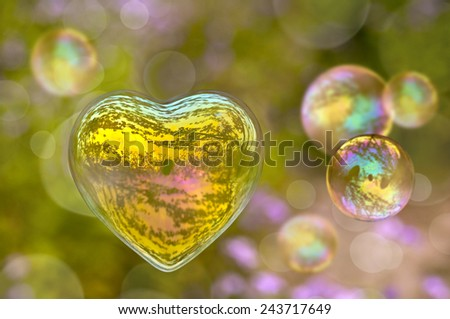 Soap bubble in the shape of a heart - stock photo