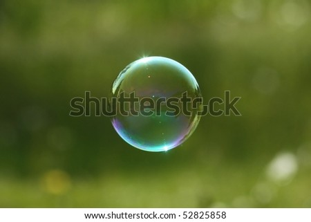 soap bubble on green background - stock photo