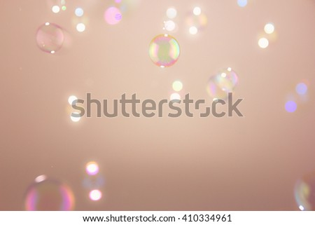 Soap bubbles blur focus  on a yellow background - stock photo