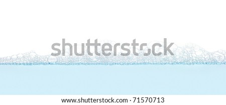 Soap bubbles filled with white background - stock photo