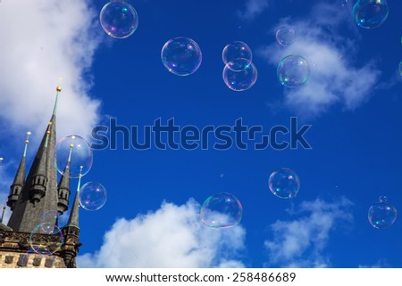 soap bubbles in the sky left tower Old City Hall, Prague Czech Republic - stock photo