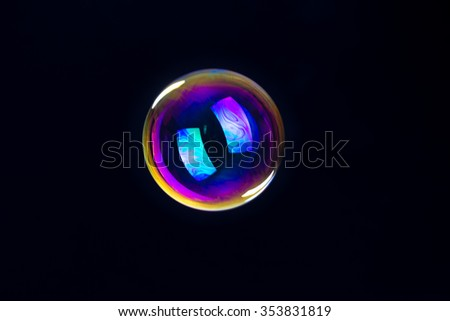 soap bubbles isolated on black background - stock photo