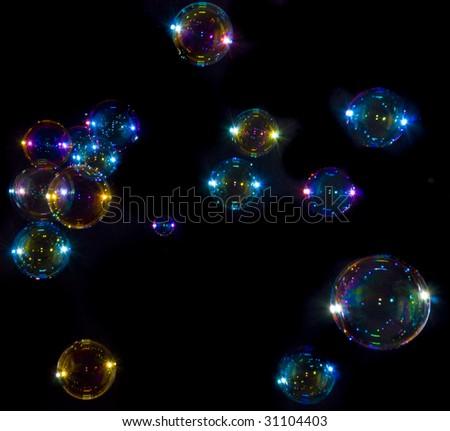Soap bubbles on black background - stock photo