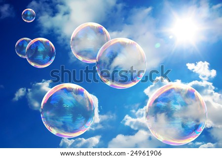 Soap bubbles on blue sky - stock photo
