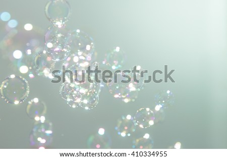 Soap bubbles on gradation a green background - stock photo