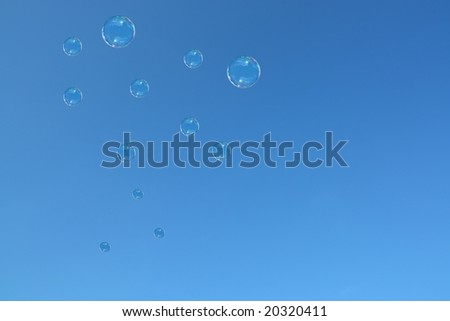 soap bubbles over blue background - stock photo