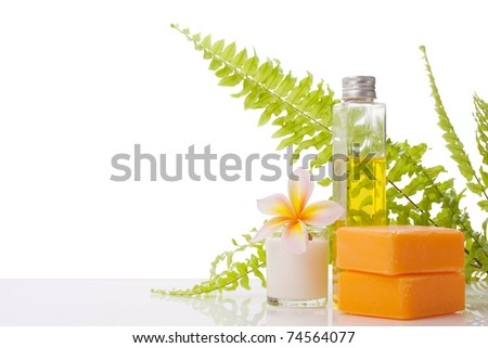 soap decorated with leelawadee flower and fern leaf on white, with copy space and paths - stock photo
