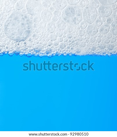 soap froth on the water - stock photo