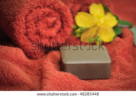 Soap on a towel with a blossom