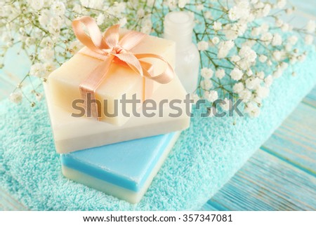 Soap set over towel background, close up - stock photo