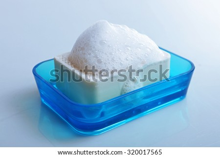 Soap with foam isolated on white - stock photo