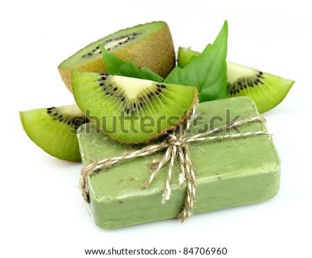 Soap with fresh kiwi on the white - stock photo