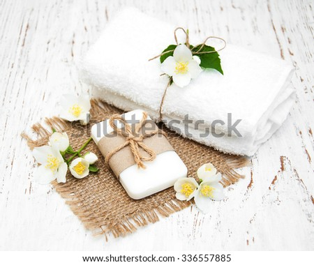 soap with jasmine flower on a wooden background