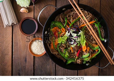 Soba noodles with beef, carrots, onions and sweet peppers. Top view - stock photo