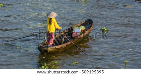 Soc Trang, Vietnam - Feb 2, 2016. A woman with wooden boat at Nga Nam floating market in Soc Trang, southern Vietnam. Nga Nam is one of famous market in southern Vietnam.