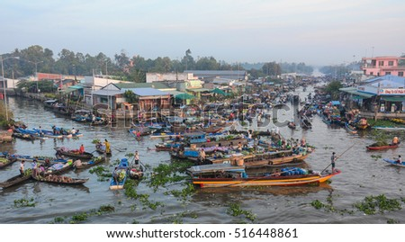 Soc Trang, Vietnam - Feb 2, 2016. People at Nga Nam floating market, group of rowing boat on river in Soc Trang, Vietnam.