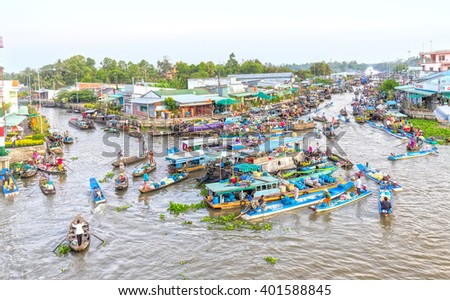 Soc Trang, Vietnam - February 3rd, 2016: Agricultural morning floating market bustling with boatload rotation trafficking intersection into river in sunny as wetland culture in Soc Trang, Vietnam