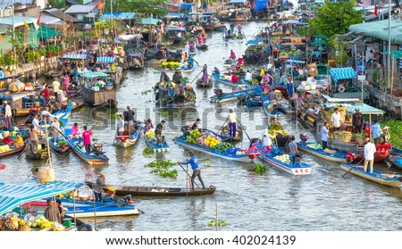 Soc Trang, Vietnam - February 3rd, 2016: Buying and selling agricultural products on river crowded with boats fruit, flowers, agricultural products on busiest floating market in Soc Trang, Vietnam