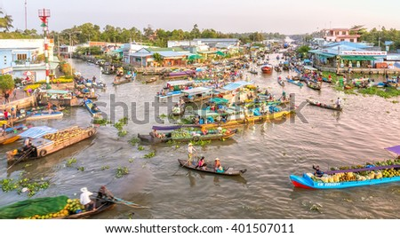 Soc Trang, Vietnam - February 3rd, 2016: Landscape floating market wetland busiest night with boats agricultural products to trade in morning preparing New Year in wetland Soc Trang, Vietnam