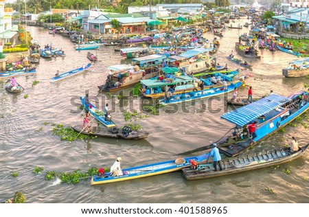 Soc Trang, Vietnam - February 3rd, 2016: Trade agricultural products in morning floating market with boatload full concentrated rotation rhythm in filthy rivers wetland sale in Soc Trang, Vietnam
