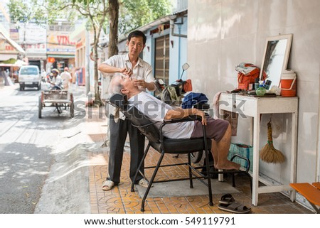 Soc Trang, Vietnam - November 13, 2016: Local barber in Chinatown area in Soc Trang, November 13, 2016, Vietnam.