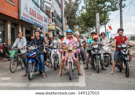 Soc Trang, Vietnam - November 13, 2016: Moped traffic in Soc Trang, November 13, 2016, Vietnam.
