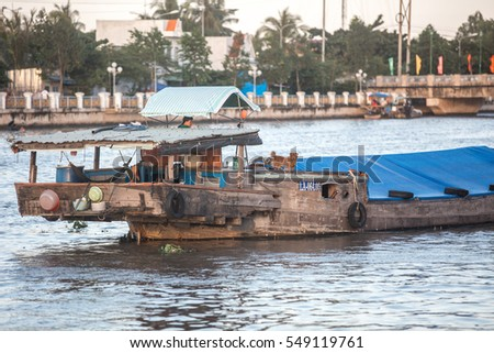 Soc Trang, Vietnam - November 13, 2016: Unidentified man on a river barge in Soc Trang, November 13, 2016, Vietnam.