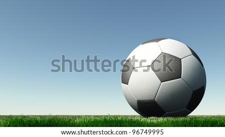 soccer a ball on a green grass. A blue unflawed sky - stock photo
