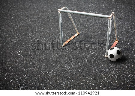 soccer ball and goal on street - stock photo