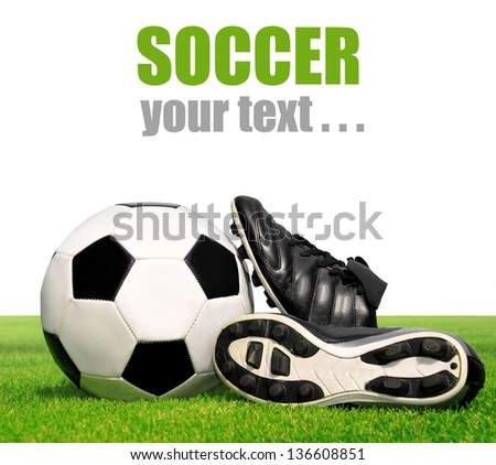 soccer ball and shoes in grass isolated on white background - stock photo