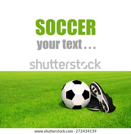 soccer ball and shoes in grass on white background