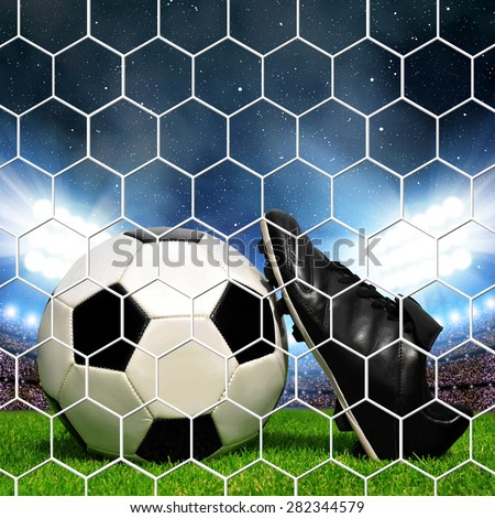 Soccer ball and shoes in grass, soccer stadium with the bright lights. - stock photo