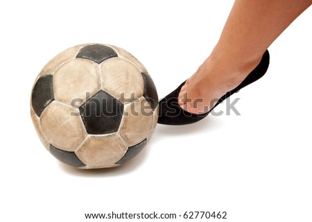 soccer ball and woman foot - stock photo