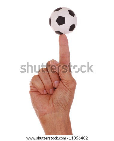 Soccer Ball Balanced on Mans Pointed Finger isolated over white - stock photo