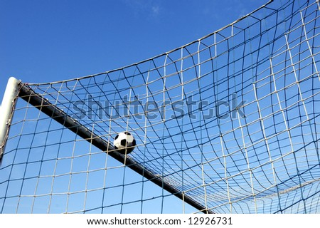 soccer ball entering the net and scoring a goal