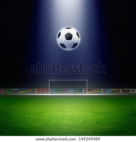 Soccer ball, green soccer stadium, arena in night illuminated bright spotlights, soccer goal - stock photo