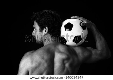 Soccer Ball Gripped by a Player in Black and White - stock photo