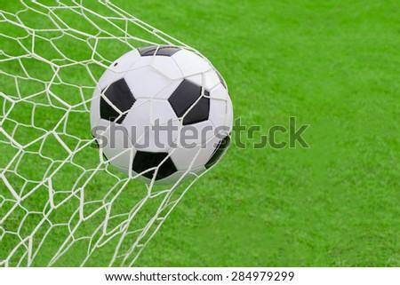 soccer ball hit the net,success goal concept