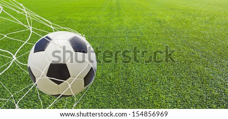 Soccer ball in a net.  - stock photo