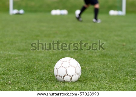 soccer ball in front of goal - stock photo
