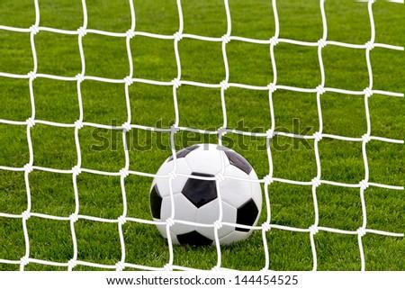 Soccer ball in goal - stock photo