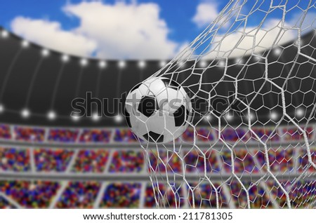 soccer ball in goal at day - stock photo