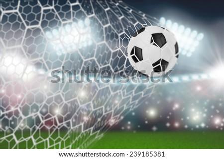 soccer ball in goal net - stock photo