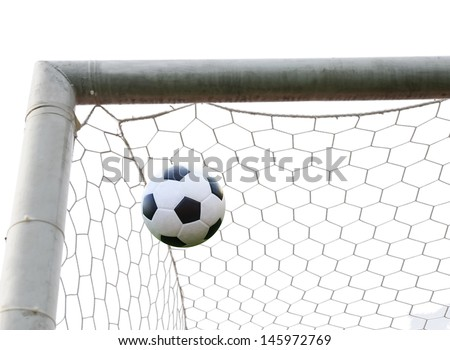 soccer ball in goal net isolated - stock photo