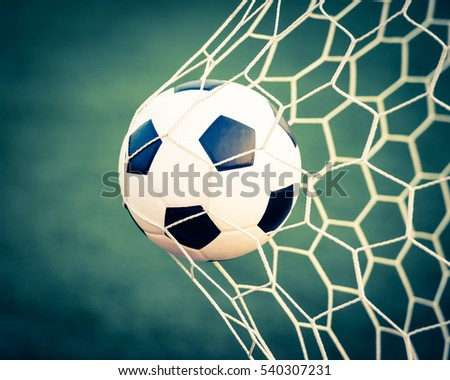soccer ball in goal net - retro vintage filter effect