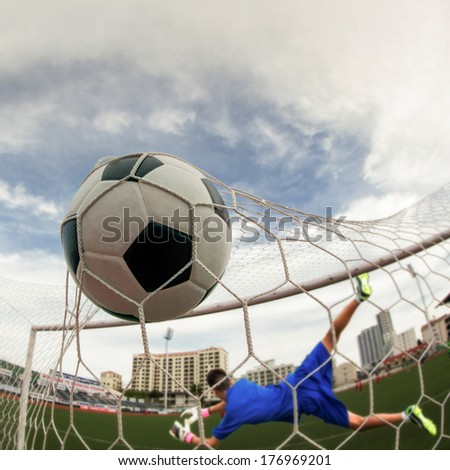 soccer ball in goal with loss goal mam - stock photo